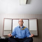 Meditating businessman